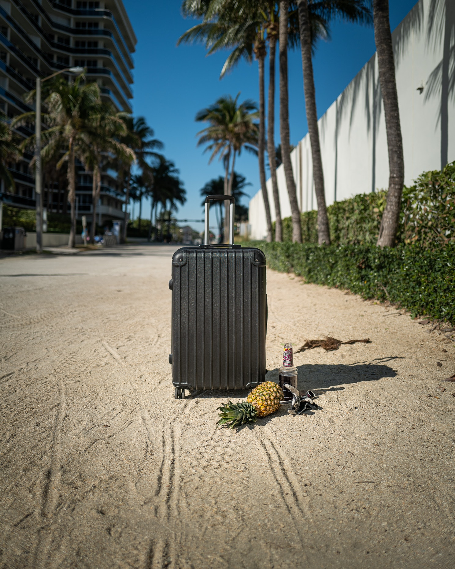 random suitcase on beach
