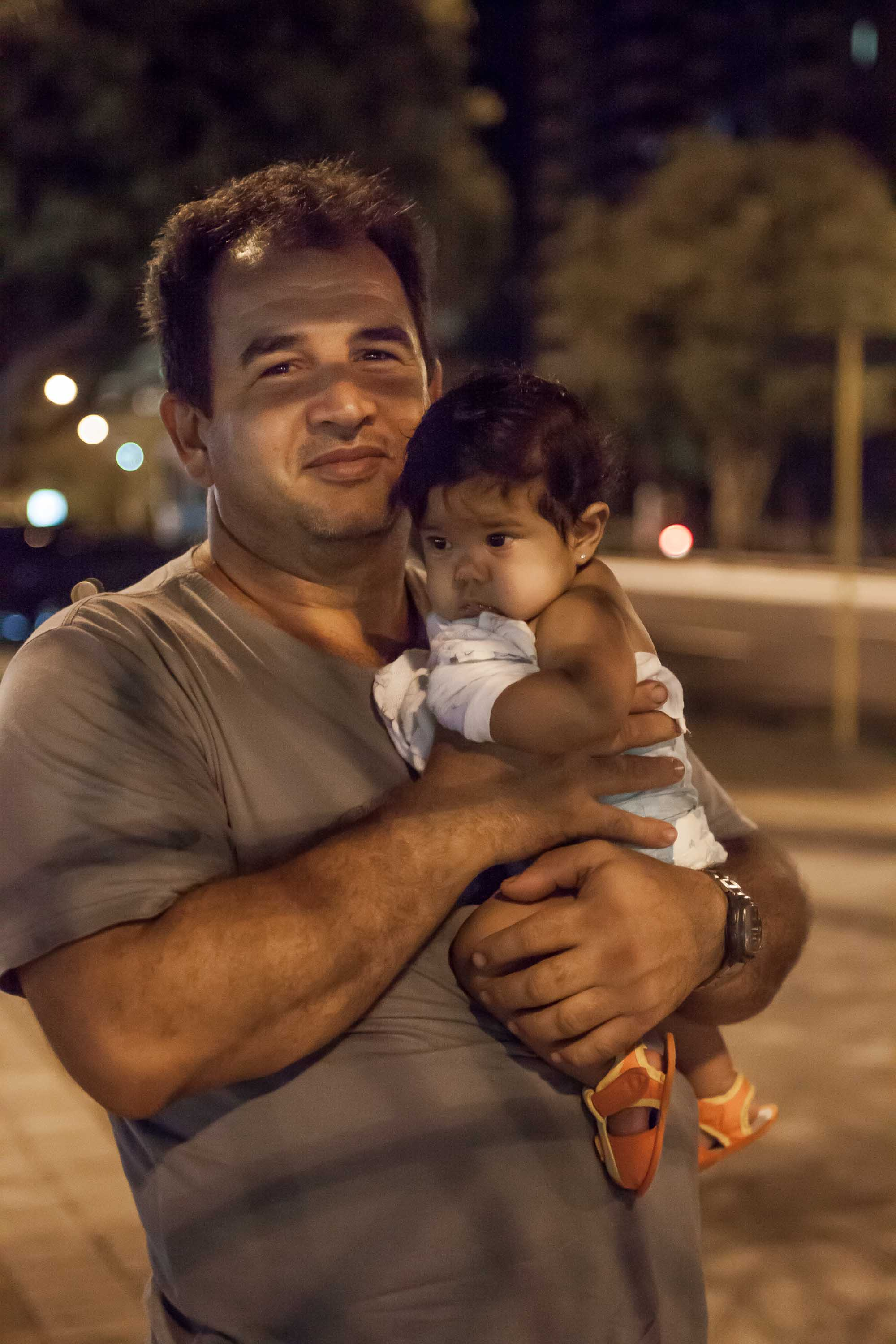man with child Manaus Amazonias Brazil